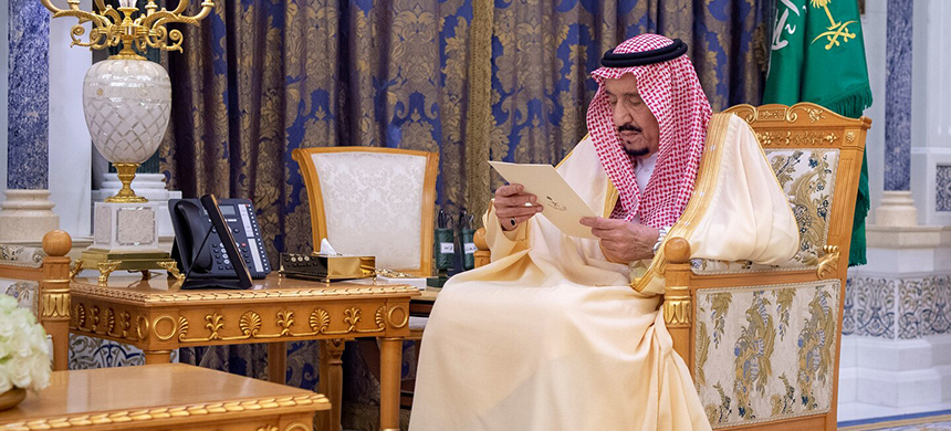 King Salman reads a document in the Royal Palace in Riyadh in a photo released Sunday by the Saudi royal court. (photo: Saudi royal court/Reuters)