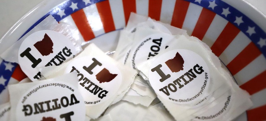 A bowl of stickers for voters in Ohio. (photo: Gene J. Puskar)