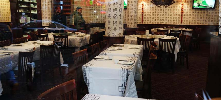 A restaurant in New York's Chinatown has no customers. (photo: Getty Images)
