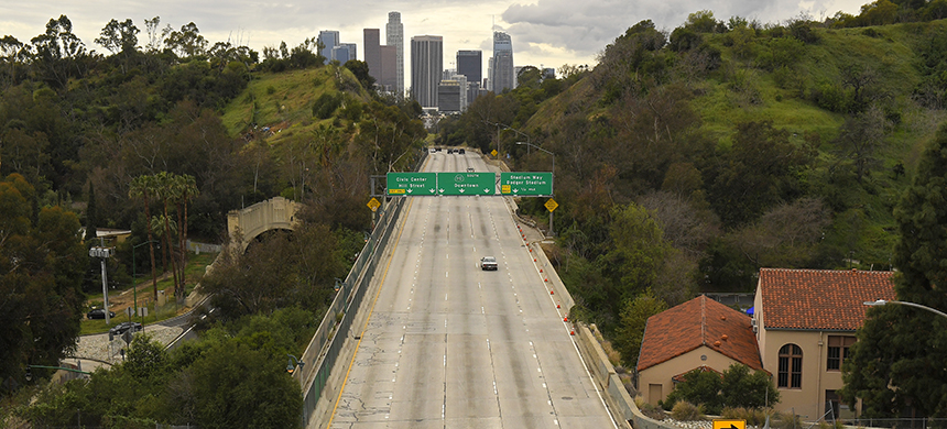 The 110 Harbor Freeway toward central Los Angeles on Friday afternoon, a time when traffic would normally be bumper-to-bumper. (photo: Mark J. Terrill/AP)