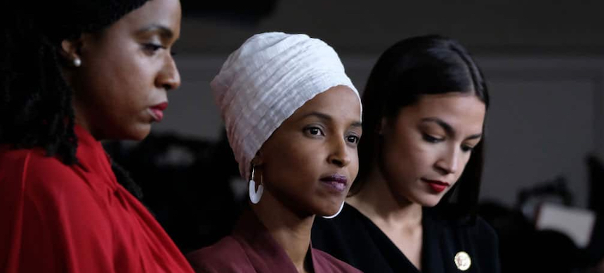 Representatives Ayanna Pressley, Ilhan Omar and Alexandria Ocasio-Cortez. (photo: Mandel Ngan/Getty Images)