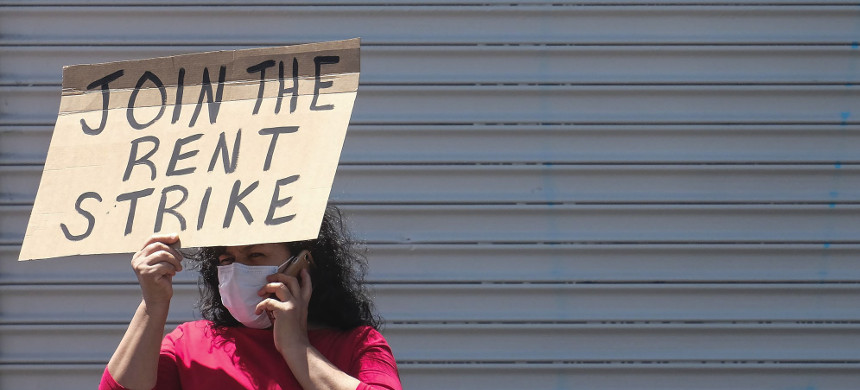 A demonstrator demands a rent strike in Los Angeles on April 21, 2020. (photo: Ringo Chiu/Zuma Press)