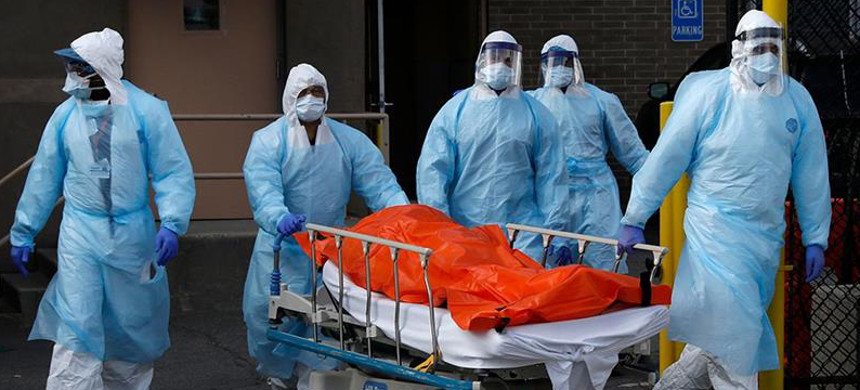 Healthcare workers wheel the body of deceased person from the Wyckoff Heights Medical Center during the outbreak of COVID-19 in the Brooklyn borough of New York City. (photo: Brendan McDermi/Reuters)