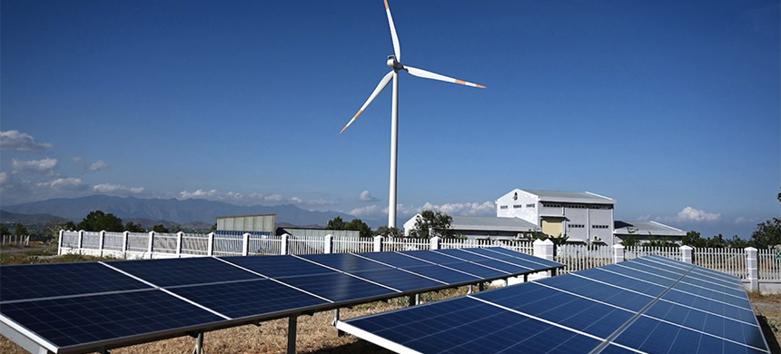 Solar panel installations and a wind turbine. (photo: AFP/Getty Images)