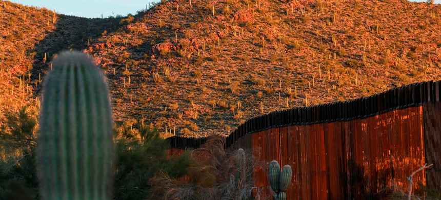 The United States-Mexico border wall is seen in Organ Pipe national park south of Ajo, Arizona, in February. (photo: Sandy Huffaker/Getty)