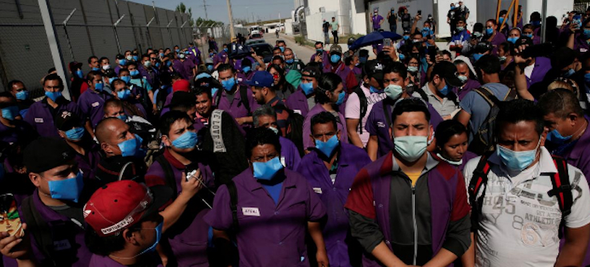 Employees of Regal, an assembly factory that manufactures electric motors, hold a protest to demand respect for the coronavirus quarantine. (photo: Jose Luis Gonzalez/Reuters)