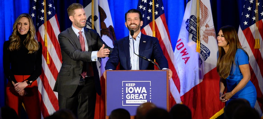 Donald Trump Jr. (C) speaks with his brother Eric (2nd L) and wife Lara, as well as his girlfriend Kimberly Guilfoyle (R) during a 'Keep Iowa Great' press conference in Des Moines, IA, on February 3, 2020. (photo: Jim Watson/Getty Images)