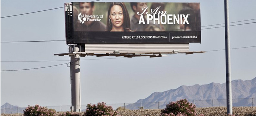 In this Nov 24, 2009 file photo, a University of Phoenix billboard is shown in Chandler, Ariz. (photo: AP)