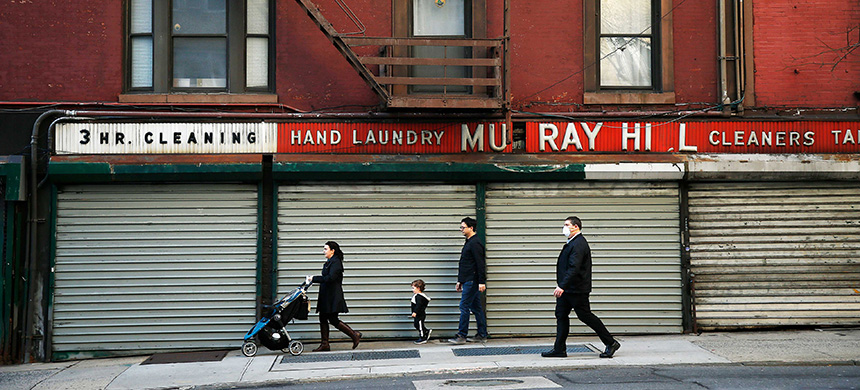 Pedestrians walk past closed shops along Lexington Avenue in New York City on April 7. About 1.2 million people in New York alone are now unemployed, in addition to 22 million people nationwide. (photo: John Lamparski/Getty Images)