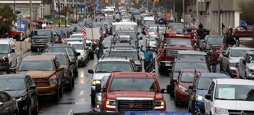 Vehicles sit in gridlock during a protest in Lansing, Michigan, over lockdown measures during the coronavirus pandemic. (photo: AP)