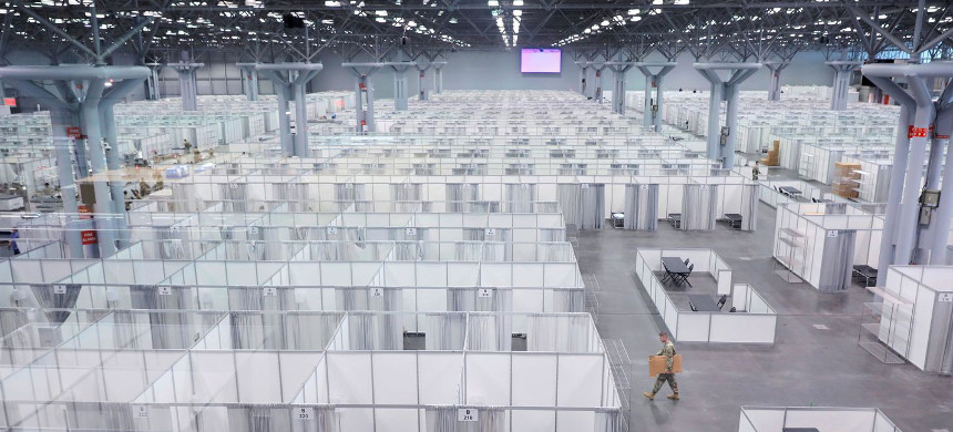 A soldier walks among cubicles being prepared at the Jacob K. Javits Convention Center in Manhattan on April 3. (photo: Andrew Kelly/Reuters)