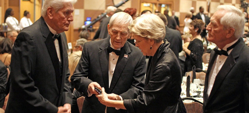 Elizabeth Warren with her three brothers in Oklahoma City in November 2011. Donald Reed Herring is center. (photo: Darren Durlach/Getty)
