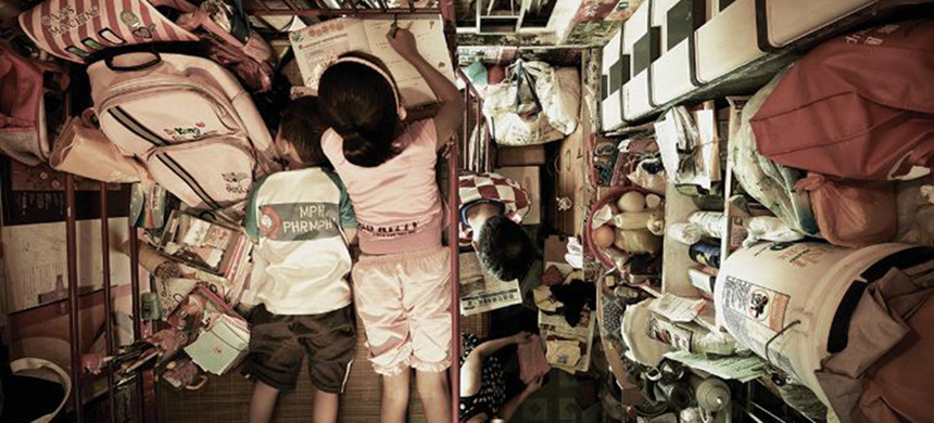 Inside of one of Hong Kong's 'cage homes.' (photo: Society for Community Organization/CNN)