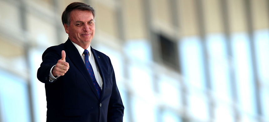 Brazilian president Jair Bolsonaro outside the Planalto Palace in Brasília on Monday. (photo: Ueslei Marcelino/Reuters)