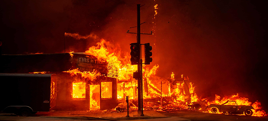 A store burns as the Camp fire tears through Paradise, California. (photo: Josh Edelson/AFP/Getty Images)