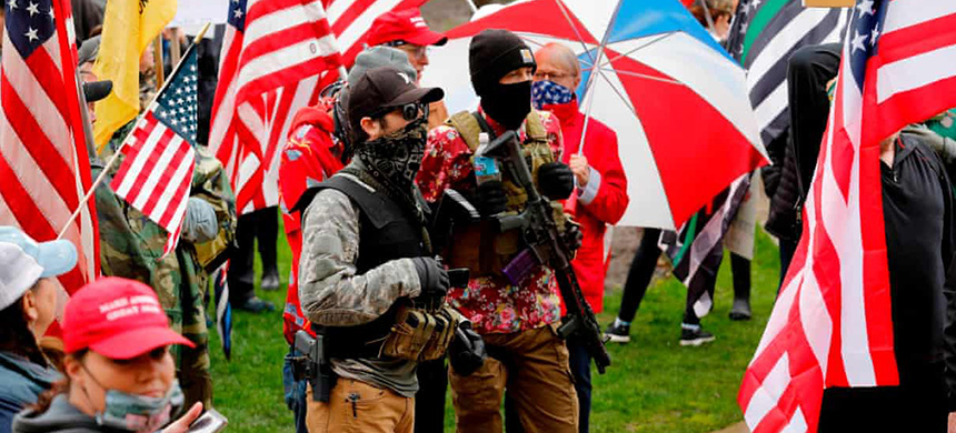 Armed protesters during a demonstration in Lansing, Michigan, on 30 April. (photo: Jeff Kowalsky/AFP/Getty Images)