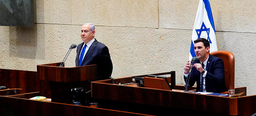 Israeli prime minister Benjamin Netanyahu, left, speaks Sunday during a swearing-in ceremony of his new unity government with election rival Benny Gantz, at the Knesset, Israel's parliament, in Jerusalem, Sunday, May 17, 2020. (photo: Adina Valman/AP)