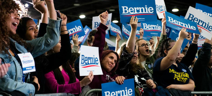 Supporters cheer in the crowd during a campaign rally for Democratic presidential candidate Sen. Bernie Sanders. (photo: Getty)