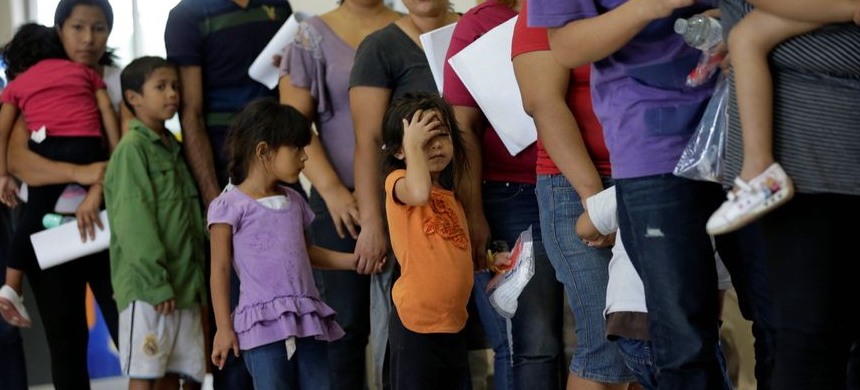 'As the nation remains focused on COVID-19, the U.S. government has aggressively begun to rush the deportations of some of the most vulnerable migrant children in its care.' (photo: Eric Gay/AP)