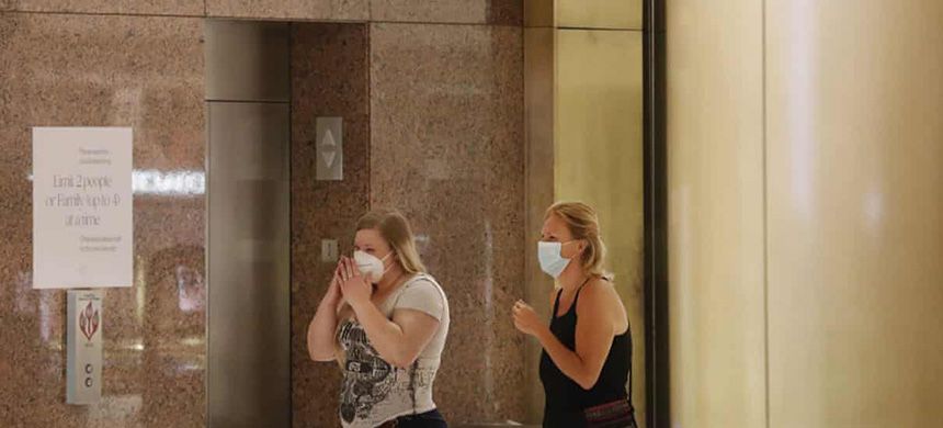 Shoppers wear masks at the Galleria Dallas mall in Texas on 4 May. (photo: LM Otero/AP)