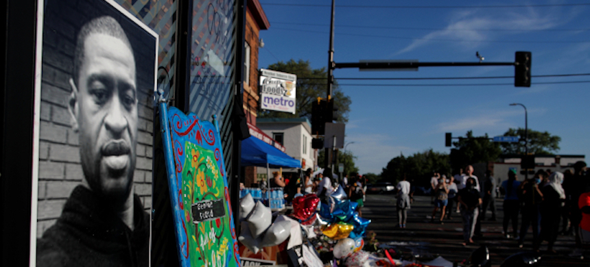 A memorial to George Floyd set up near where he was arrested. (photo: Carlos Barria/Reuters)