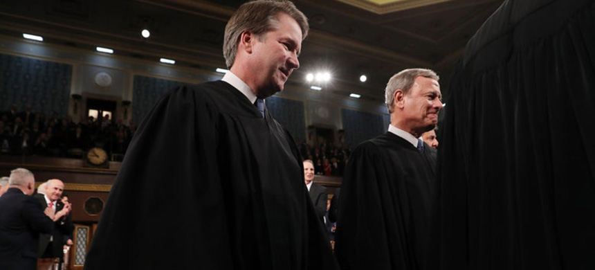 Supreme Court Justice Brett Kavanaugh and Chief Justice John Roberts arrive to hear President Donald Trump deliver the State of the Union address in the House chamber on February 4, 2020 in Washington, D.C. (photo: Getty Images)