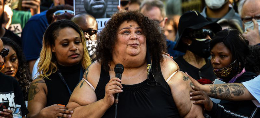 George Floyd's niece Angel Buechner speaks during a protest outside the residence of governor of Minnesota Tim Walz, over his death, an unarmed black man, who died after a police officer kneeled on his neck for several minutes on June 1, 2020 in Minneapolis. (photo: Chandan Khanna/AFP/Getty Images)