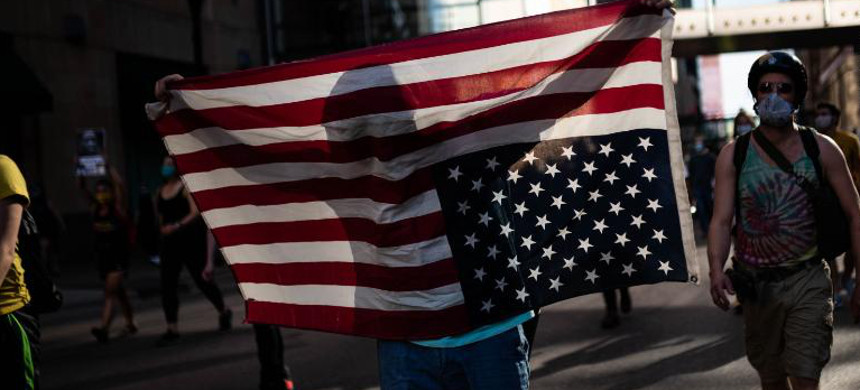 Protester holds an American flag upside-down. (photo: Stephen Maturen/Getty)