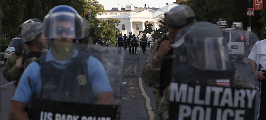 Authorities clear Lafayette Park in Washington, D.C., on Monday, while across the street at the White House, President Trump said he would send the military to U.S. cities if local officials don't end unrest. (photo: Alex Brandon/AP)