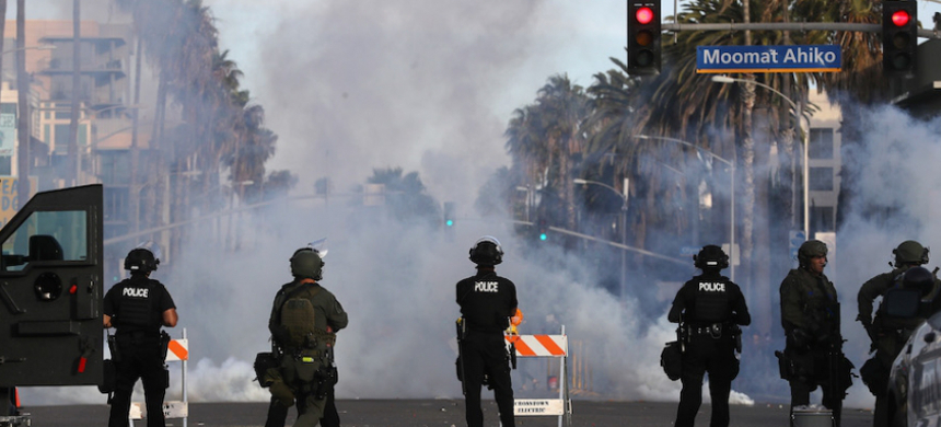 Protests turned violent in Santa Monica, California, on May 31, after police officers attack demonstrators with tear gas in the aftermath of the police murder of George Floyd. (photo: Mario Tama/Getty)
