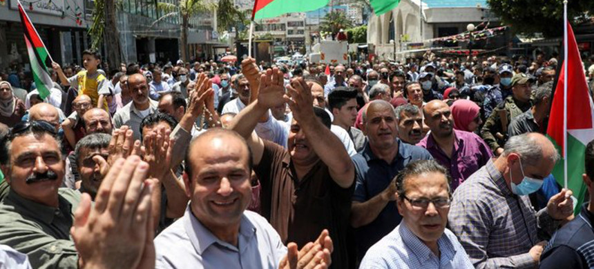 Palestinians gather to protest against Israeli plans to annex parts of the occupied West Bank. (photo: AFP)