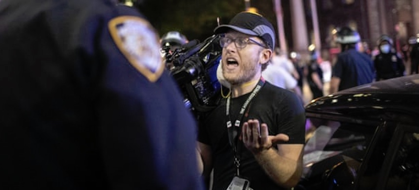 AP journalist Robert Bumsted reminds a police officer that the press are considered 'essential workers.' NYPD officers surrounded, shoved and yelled expletives at him and his co-worker. (photo: Wong Maye-E/AP)