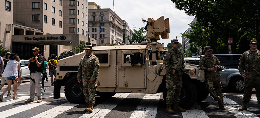 National Guard troops patrolling near the White House on Saturday. (photo: Anna Moneymaker/NYT)
