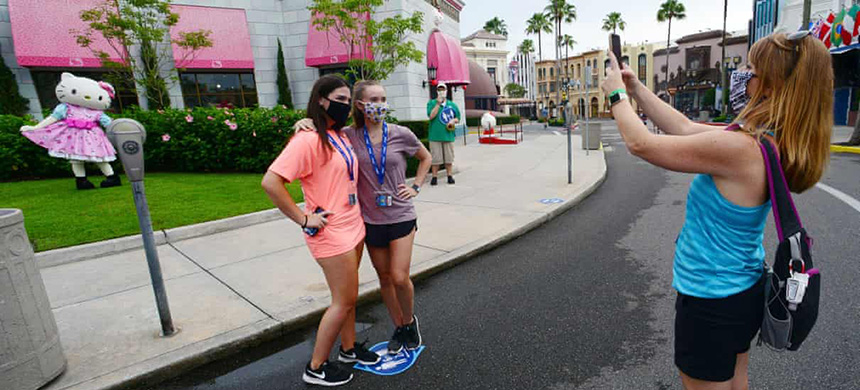 Visitors take a picture at Universal Studios theme park on the first day of reopening from the coronavirus pandemic on Friday, in Orlando, Florida. (photo: Gerardo Mora/Getty Images)
