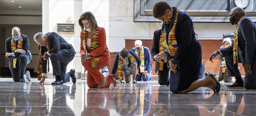 House Speaker Nancy Pelosi of Calif., center, and other members of Congress, kneel and observe a moment of silence at the Capitol's Emancipation Hall, Monday, June 8, 2020, on Capitol Hill in Washington, reading the names of George Floyd and others killed during police interactions. (photo: Manuel Balce Ceneta/AP)