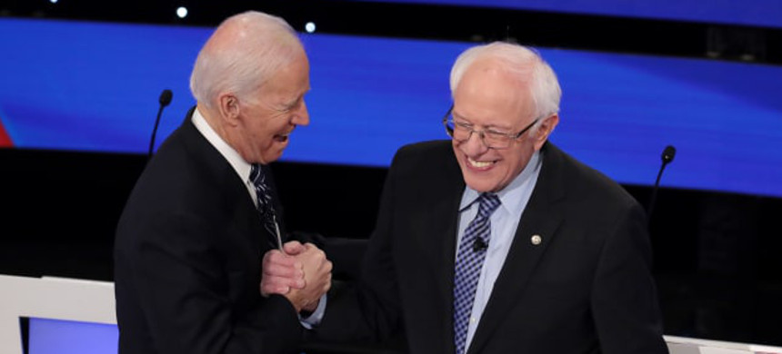 Former vice president Joe Biden greets Sen. Bernie Sanders before the Democratic presidential primary debate at Drake University on January 14, 2020 in Des Moines, Iowa. (photo: Scott Olson/Getty)