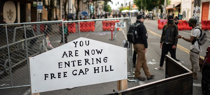 A sign on a barrier at an entrance to the 'Capitol Hill Autonomous Zone' in Seattle on Wednesday, June 10, 2020. (photo: David Ryder/Getty Images)