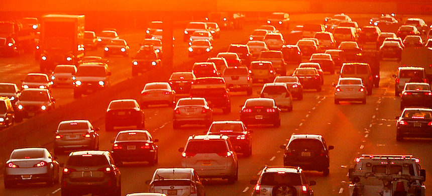 'As the world slowly returns to something resembling 'normal,' traffic is on the rise.' (photo: Al Seib/Getty Images)