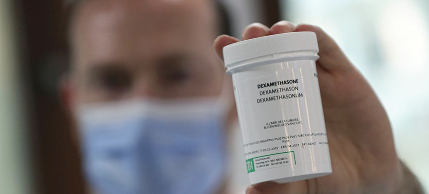 A pharmacist displays a box of Dexamethasone at the Erasme Hospital amid the coronavirus disease (COVID-19) outbreak, in Brussels, Belgium, June 16, 2020. (photo: Yves Herman/Reuters)