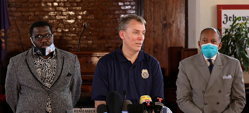 New York City Police Commissioner Dermot Shea stands with the Rev. Kevin McCall and First Deputy Police Commissioner Benjamin Tucker at a news conference in Brooklyn, N.Y., on June 3, 2020.(photo: Caitlin Ochs/Reuters)