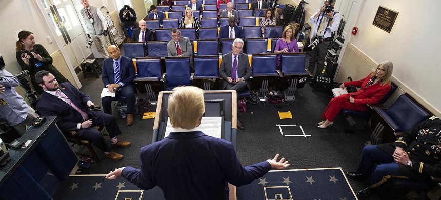 President Donald Trump speaks to reporters spaced apart in the White House briefing room during a daily coronavirus news conference.  (photo: Alex Brandon/AP)