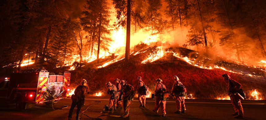 Firefighters battle the Camp Fire in Northern California in 2018. (photo: AFP)