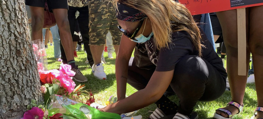 Demonstrators bring candles and flowers, June 13, 2020, around a tree where Robert Fuller was found dead June 10 in Poncitlan Square in Palmdale, California. (photo: VOA)