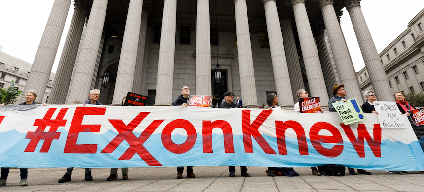Protesters outside of a New York City courthouse for a rally coinciding with the start of a legal case against ExxonMobil, October 2019. photo: Justin Lane/EPA-EFE/Shutterstock