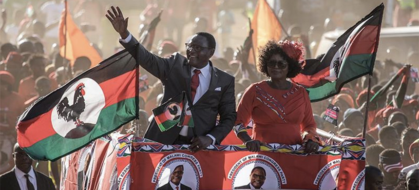 Lazarus Chakwera waves to a crowd as he arrives at his last campaign rally, in Lilongwe, ahead of the rerun general elections. Chakwera on June 27, 2020 was declared winner with 59 percent of the vote. (photo: Gianluigi Guercia/AFP)