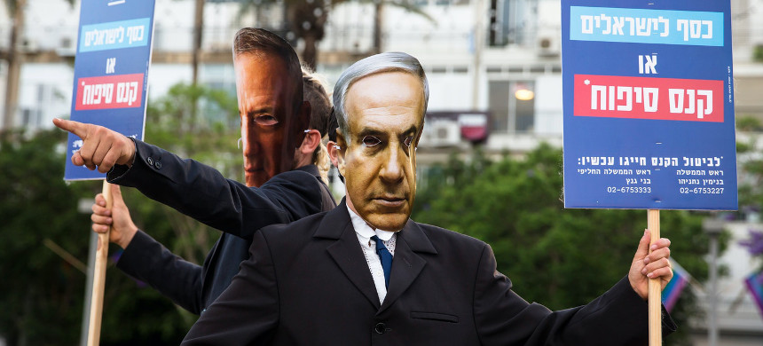 Demonstrators wear masks of Israeli Prime Minister Benjamin Netanyahu and Defense Minister Benny Gantz as they protest the plan to annex the West Bank. (photo: Amir Levy/Getty)