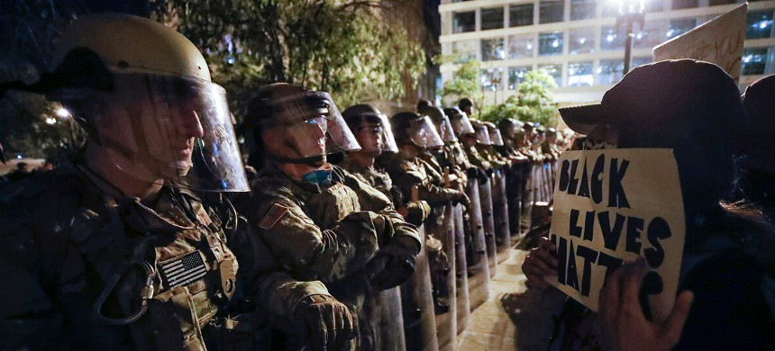 Utah National Guard soldiers line the street as demonstrators gather to protest the death of George Floyd, Wednesday, June 3, 2020, near the White House. (photo: Alex Brandon/AP)