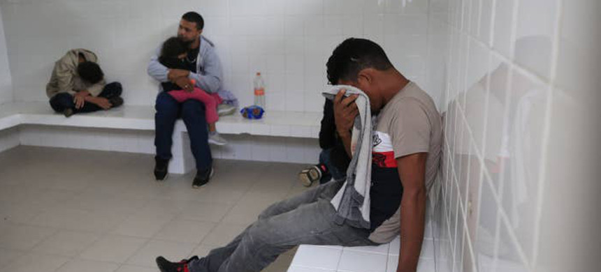 A young man, sitting with other immigrants inside a holding cell, cries as he says he will be killed if he gets sent back to Honduras, June 16, 2019. (photo: Rebecca Blackwell/AP)