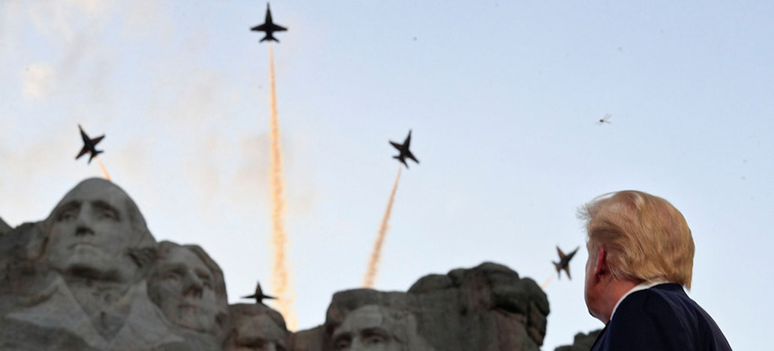 President Trump watches as U.S. Navy Blue Angels fly overhead at Mount Rushmore in Keystone, S.D., on July 3, 2020. (photo: Tom Brenner/Reuters)