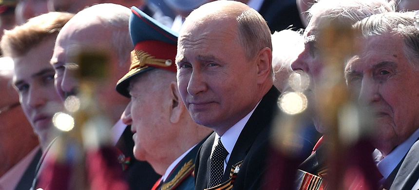 Russian President Vladimir Putin watches a Victory Day military parade on Red Square, marking the 75th anniversary of the victory in World War II, on June 24 in Moscow. (photo: Ramil Sitdikov/Host Photo Agency/Getty Images)